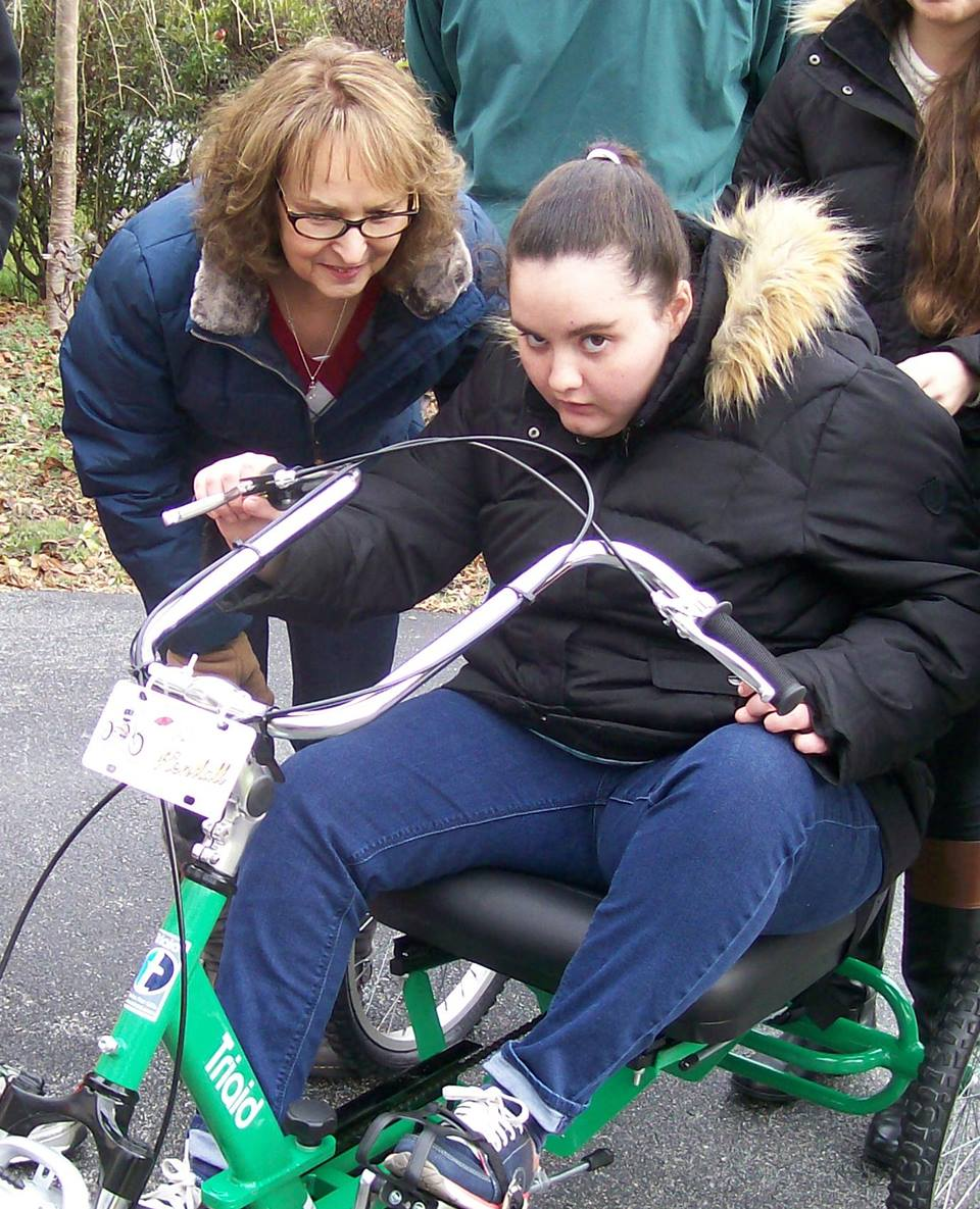 Kendall with Donna and bike